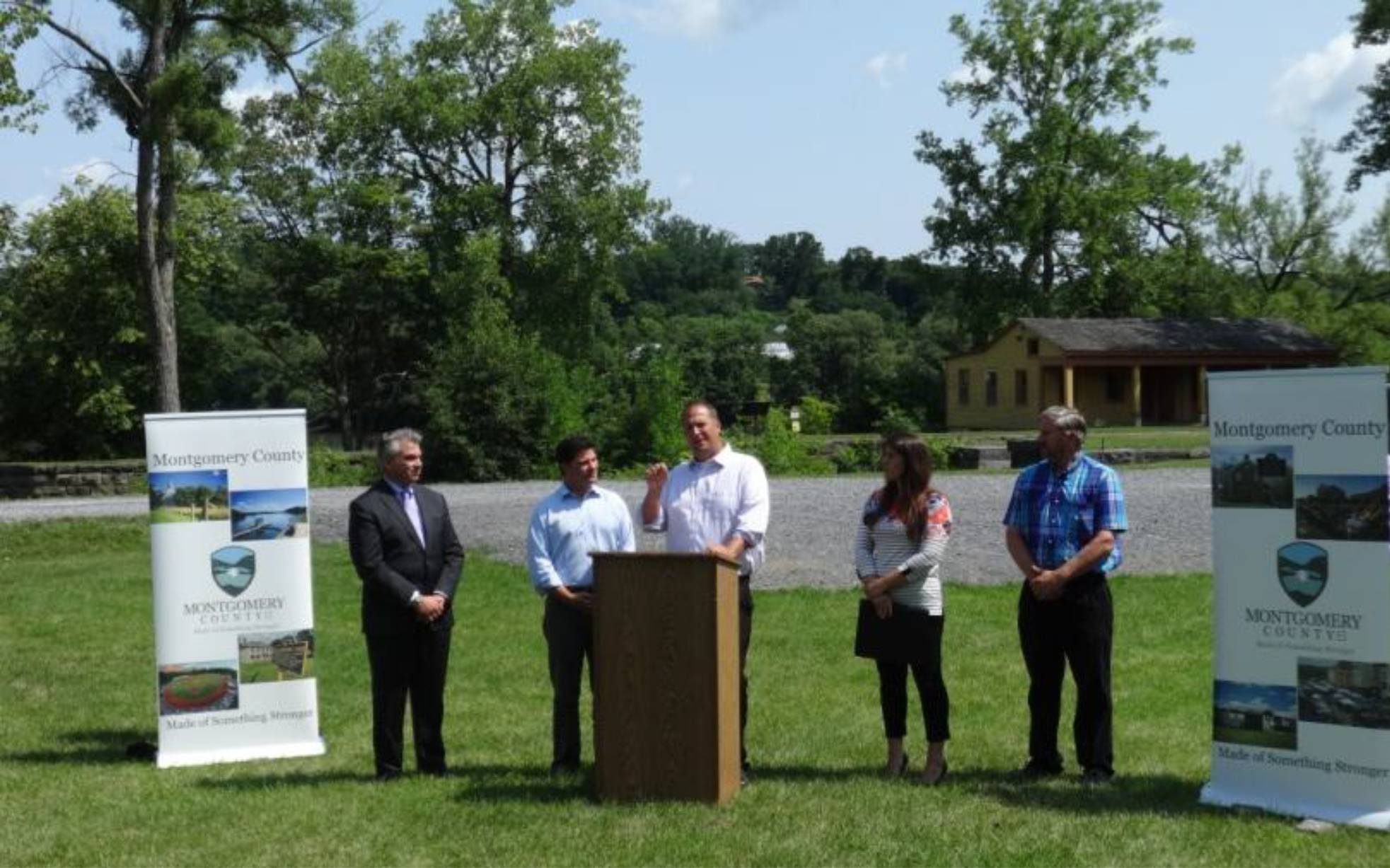 Montgomery County Executive Matthew L. Ossenfort addresses the media and the crowd at an announcement at Yankee Hill Lock.