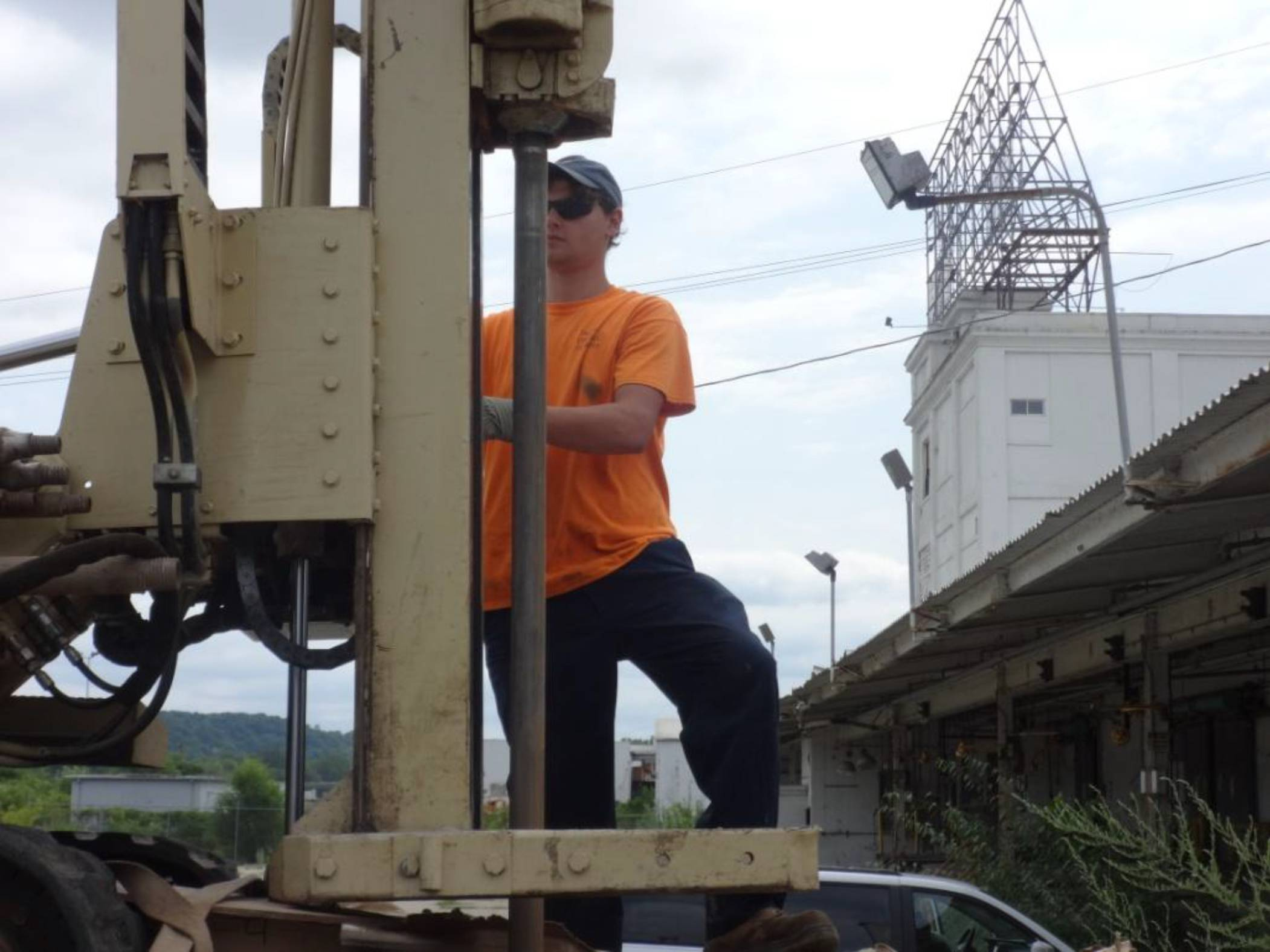 A member of Talon Drilling Company unloads the Geoprobe, which was the piece of equipment used throughout the property to drill for subsurface samples.