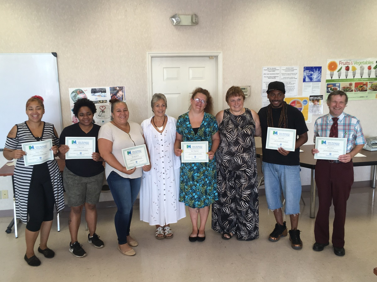 Four participants who concluded the four-week course, along with two other individuals who successfully re-entered the workforce before the course ended and the two course instructors, Heather Loucks and Ellie Fosmire