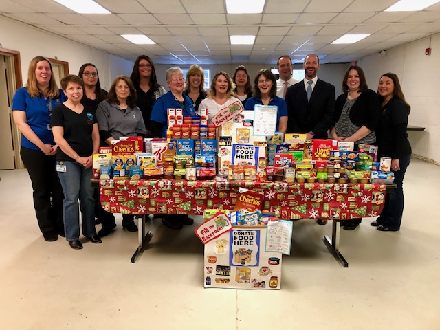 Montgomery County Executive Matthew L. Ossenfort, Fonda-Fultonville District Superintendent Thomas Ciaccio, social worker Melanie Capron, Montgomery County Public and Mental Health Director Sara Boerenko and staff pictured Monday making a donation to Fonda-Fultonville's Backpack Program.