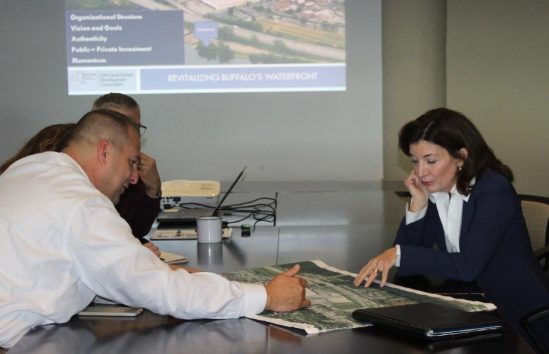 County Executive Matthew L. Ossenfort reviews a map of the Exit 29 Redevelopment Project with Lt. Gov. Kathy Hochul in Buffalo.