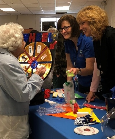 D. Dorine Dimond, of Fonda, plays a game Thursday with Immunization Coordinator Wanda Antos and Community Health Nurse Suzanne Skelton during the Public Health Department's Senior Meet and Greet.