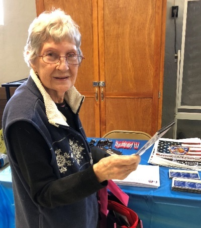 Susan Zepperi, Amsterdam, pictured Thursday with information from the Emergency Services table during the Senior Meet and Greet.