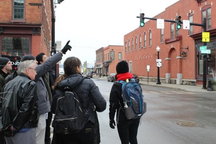 From left, Village of Canajoharie Mayor Francis Avery pictured Feb. 7 giving a tour of downtown Canajoharie to Cornell University students.