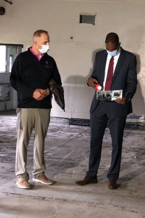 County Executive Matthew L. Ossenfort and U.S. Rep. Antonio Delgado D-19th  look at photos of demolition progress during a tour Tuesday of the Exit 29 Redevelopment Project.