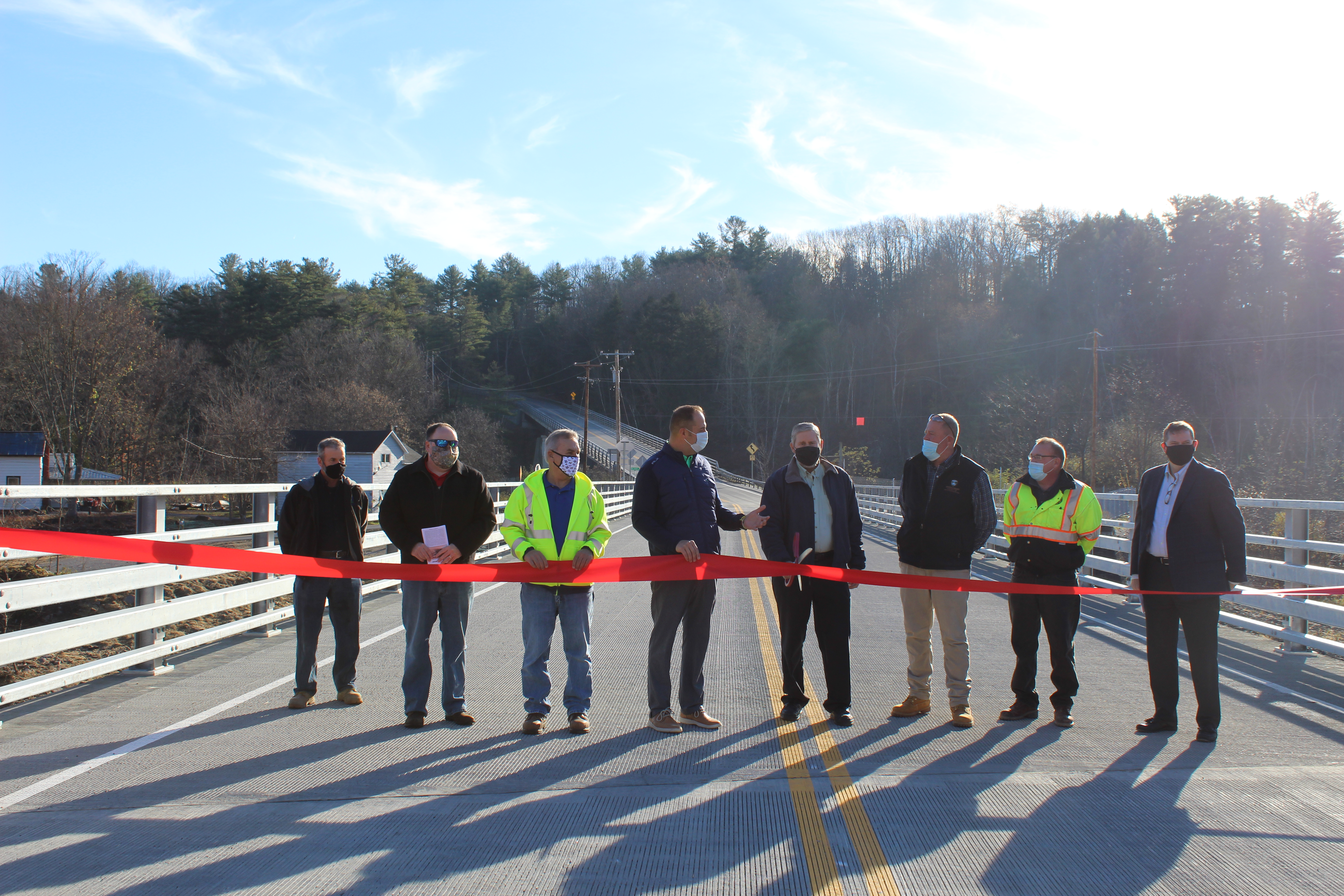 Former Department of Public Works Commissioner Paul Clayburn cuts the ribbon for the new Burtonsville Road Spur Bridge during a ceremony Thursday.