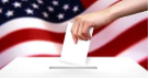 Ballot being inserted into a ballot box, with the American flag in the background