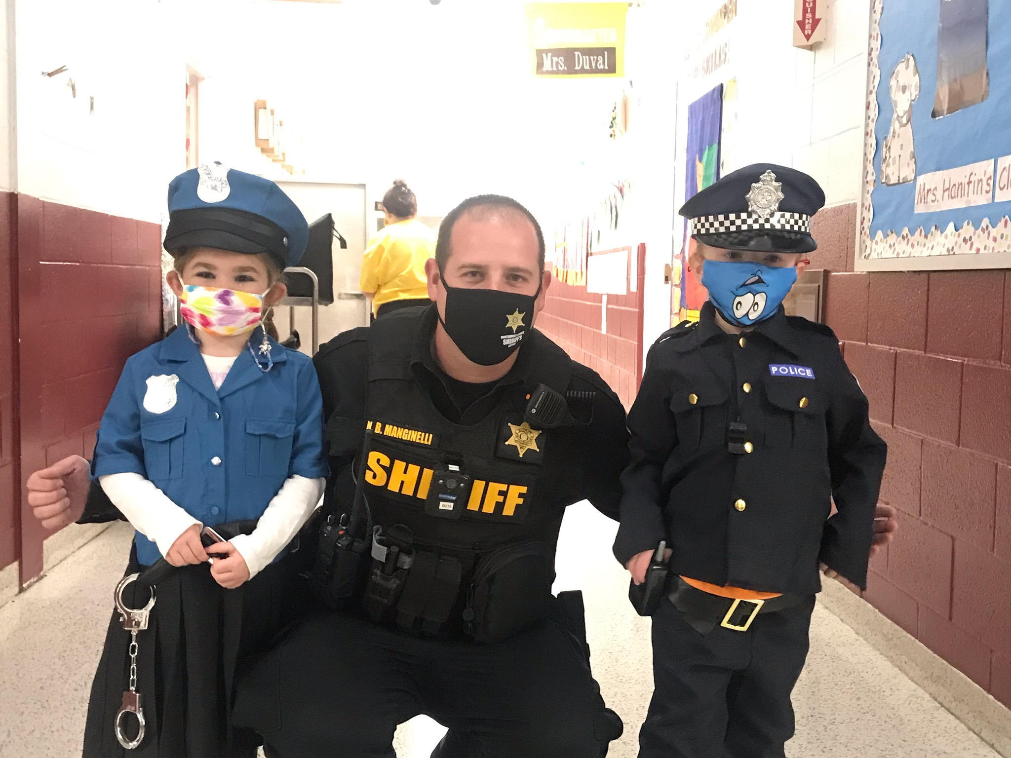 Sheriff's Office Unit with 2 children